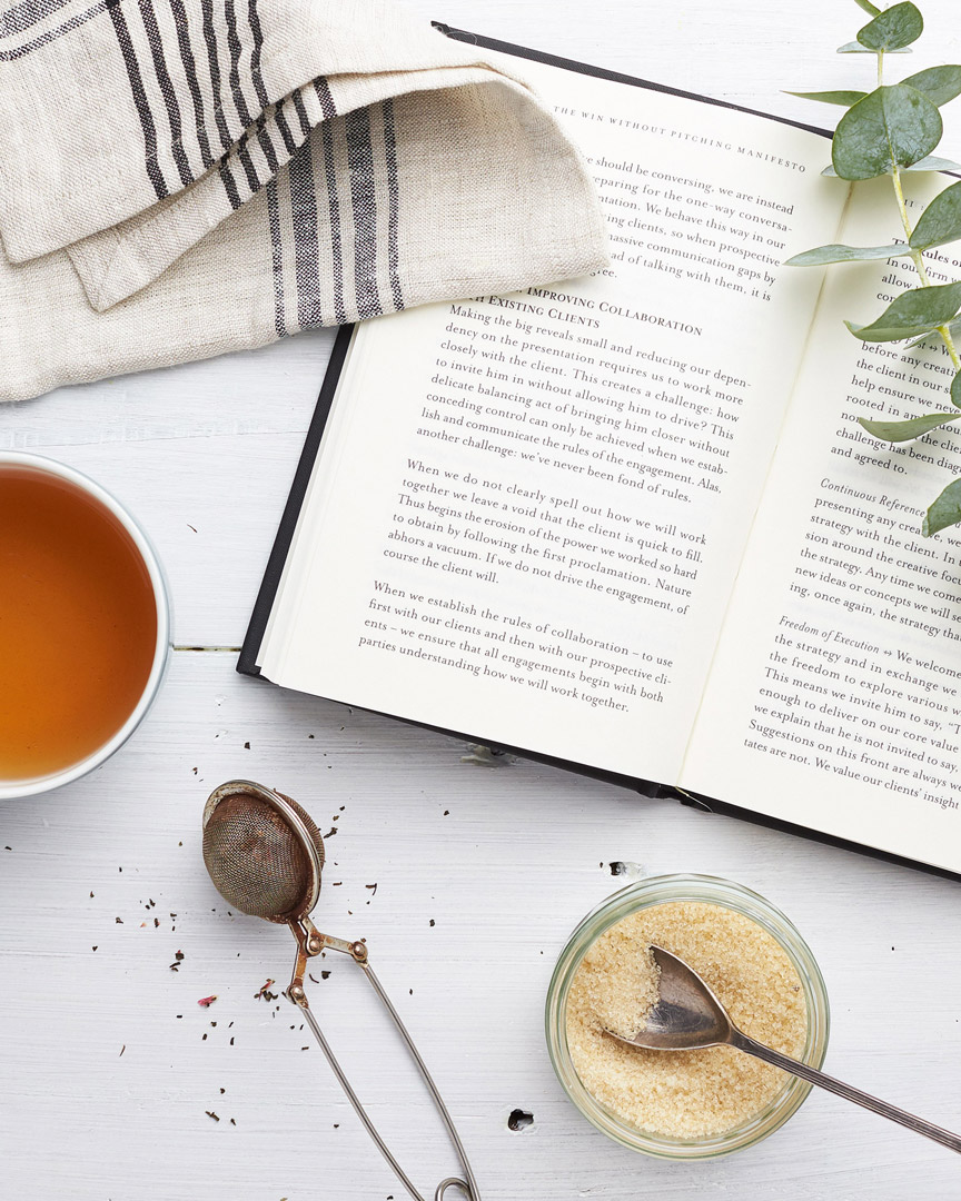 Selection of tea and book used as props for photography